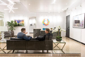 men sitting on a couch in office